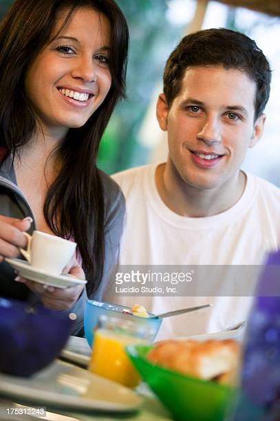 young couple at breakfast - hazel bond stock photos and pictures