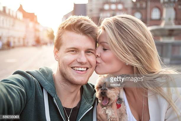 young couple at cafe with their dog. - scandinavian descent stock pictures, royalty-free photos & images
