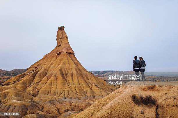 young couple at desert - mid distance stock pictures, royalty-free photos & images