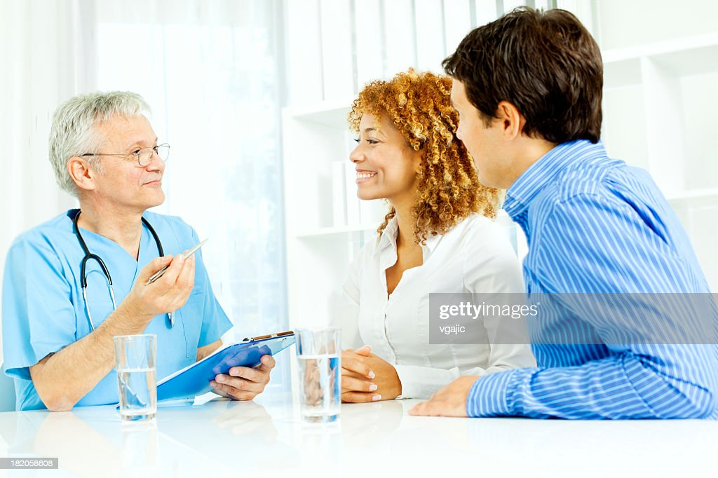 Young couple at doctors office. : Stock Photo