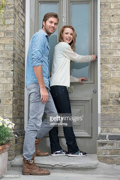 Young Couple at Front Door