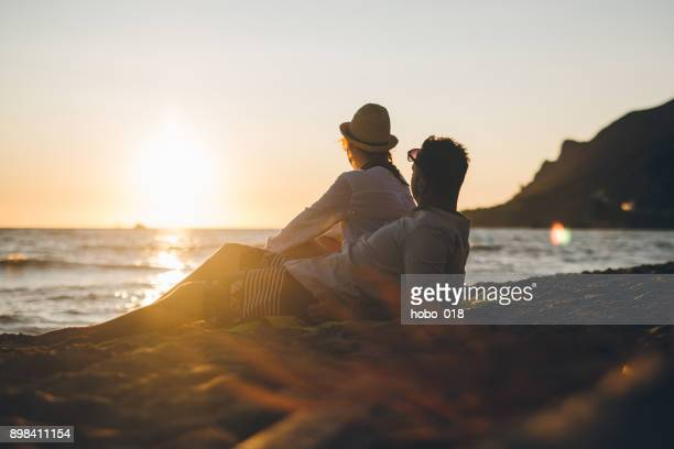 Young couple at Greece beach in sunset