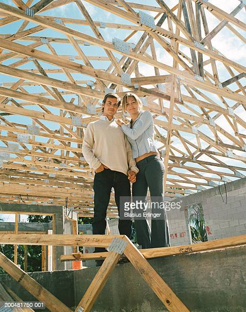 young couple at home construction site - blasius erlinger stock pictures, royalty-free photos & images
