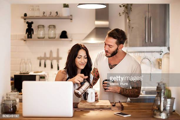 Young couple at home - Morning breakfast time