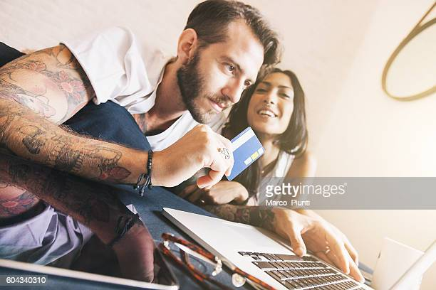 Young couple at home - Online Shopping