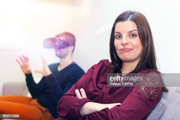 Young couple at home using virtual mask