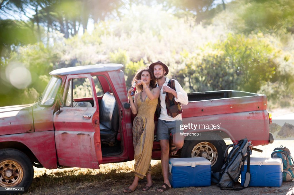Young Couple At Old Pick Up Truck Stock Photo | Getty Images