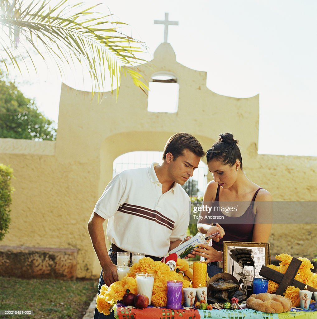 Young couple at shrine in front of church gate : Stock Photo