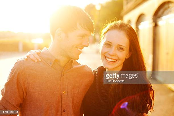 young couple at sunset. - heterosexual couple stock pictures, royalty-free photos & images
