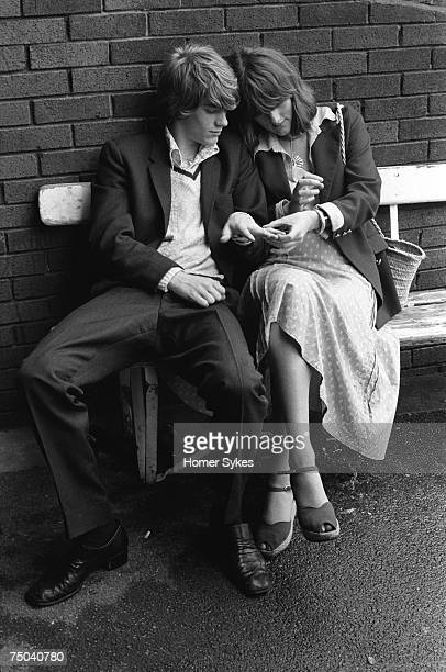 A young couple at the annual Eton vs Harrow cricket match trying on rings for size Lord's cricket ground St Johns Wood 1975