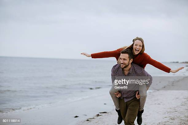 young couple at the beach - northern european descent stock pictures, royalty-free photos & images