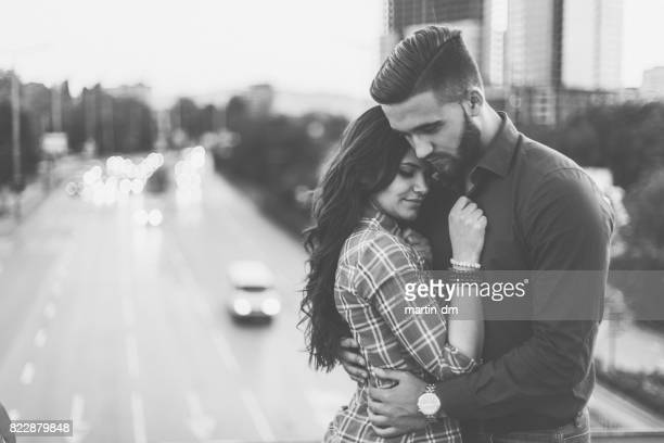 young couple at the bridge falling in love - lust girl stock photos and pictures