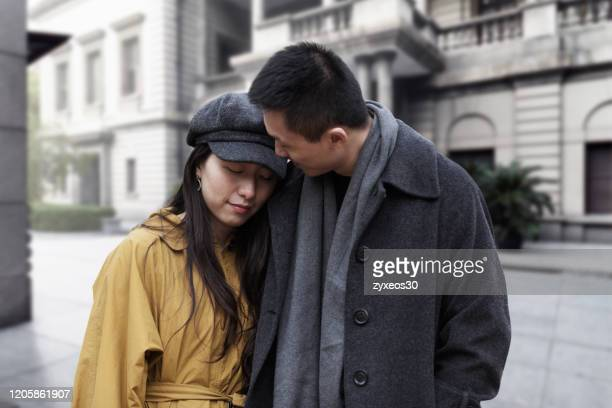 a young couple at the bund in shanghai,china - east asia, - china east asia stock pictures, royalty-free photos & images
