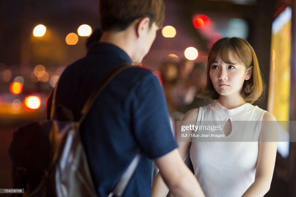Young couple at the bus stop : Stock Photo