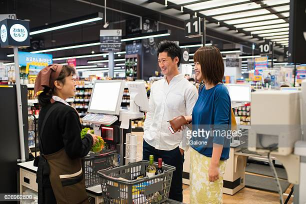 Young couple at the checkout