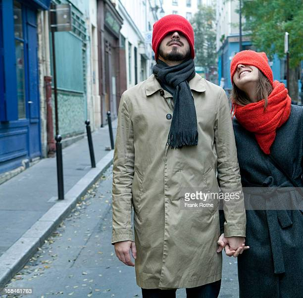 young couple at the street holding hands - pañuelo rojo fotografías e imágenes de stock