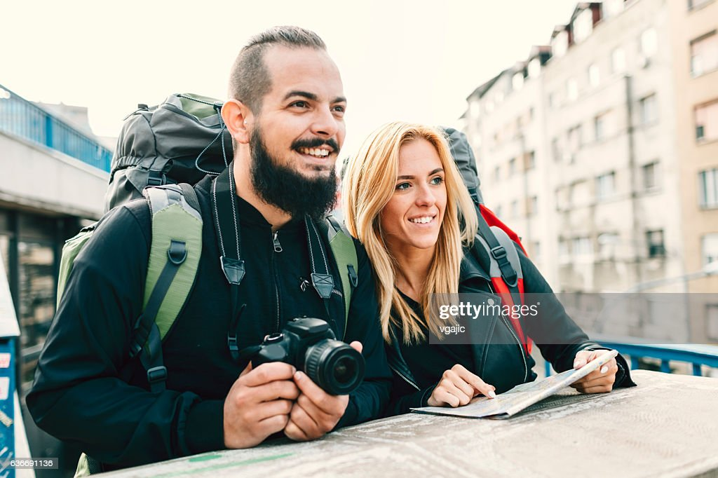 Young Couple Backpackers In The City : Stock Photo