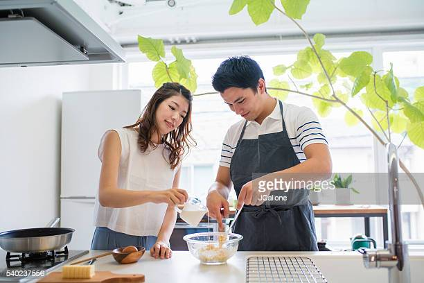 Young couple baking together in the kitchen