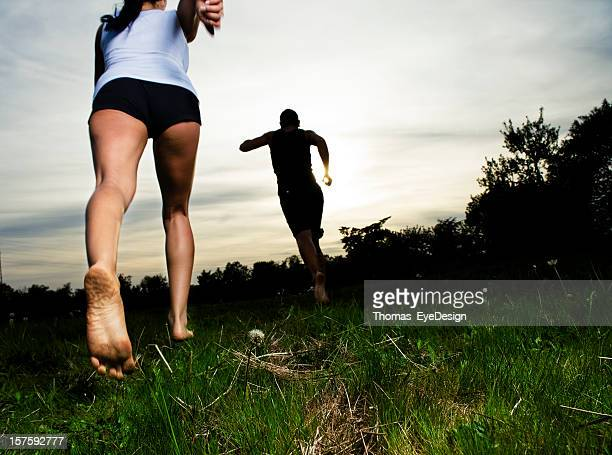 young couple barefoot running - barefoot stock pictures, royalty-free photos & images