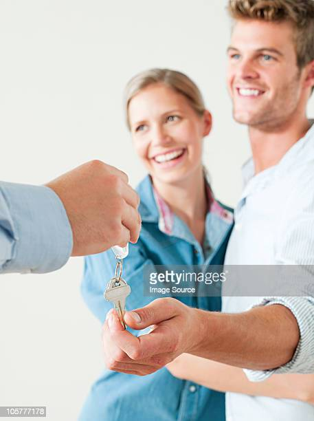Young couple being handed house keys