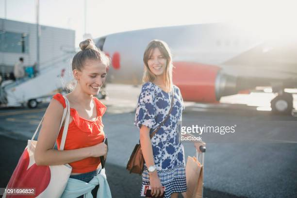 young couple boarding their plane - airfield stock pictures, royalty-free photos & images
