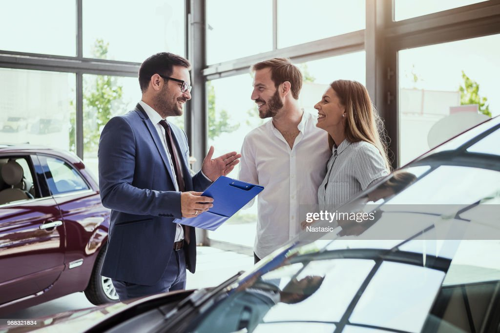Young couple buying a car : Stock Photo