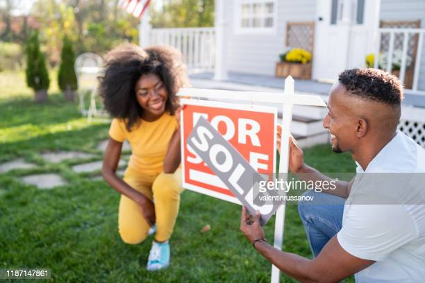 young couple buying a new house - vendor stock pictures, royalty-free photos & images