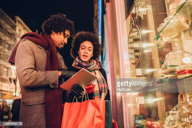Young couple buying Christmas presents online