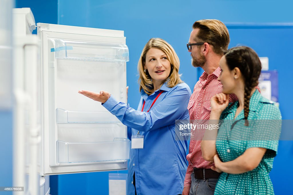 Young Couple Buying Refrigerator In Appliance Store : Stock Photo