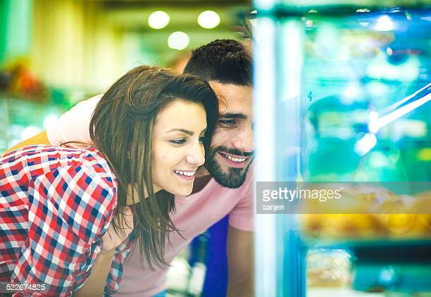 Young couple buying sweets