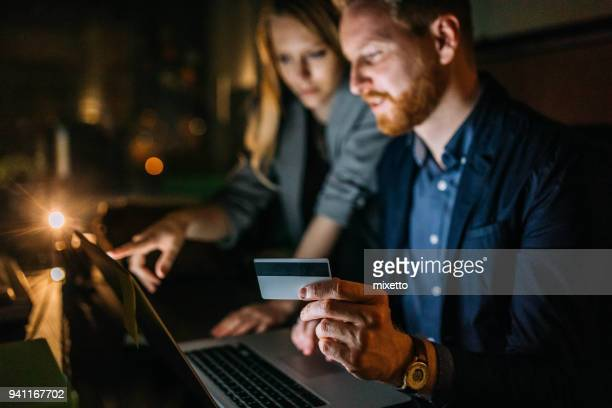 young couple buys with credit card - ecommerce stock pictures, royalty-free photos & images