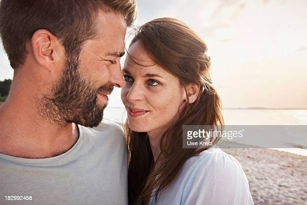 Young couple by the sea, close up