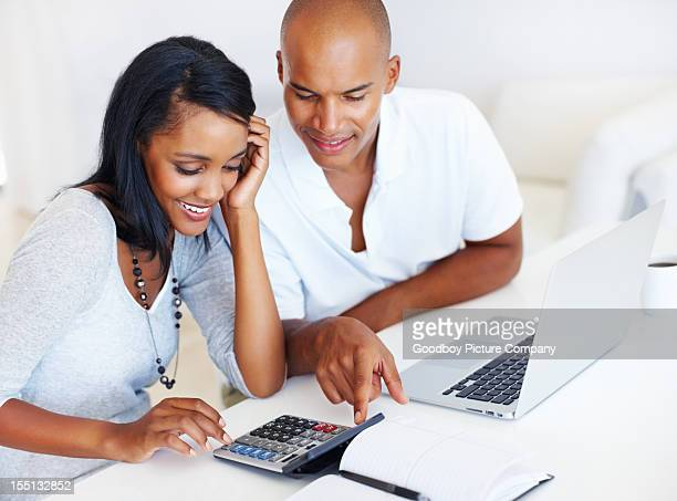 Young couple calculating expenses