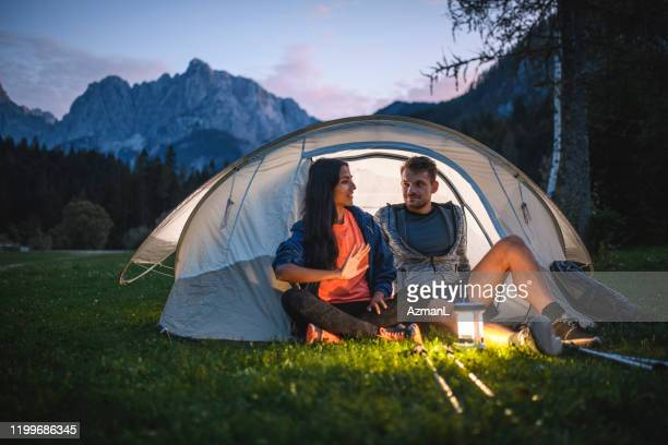 young couple camping in northwestern slovenia - lantern stock pictures, royalty-free photos & images