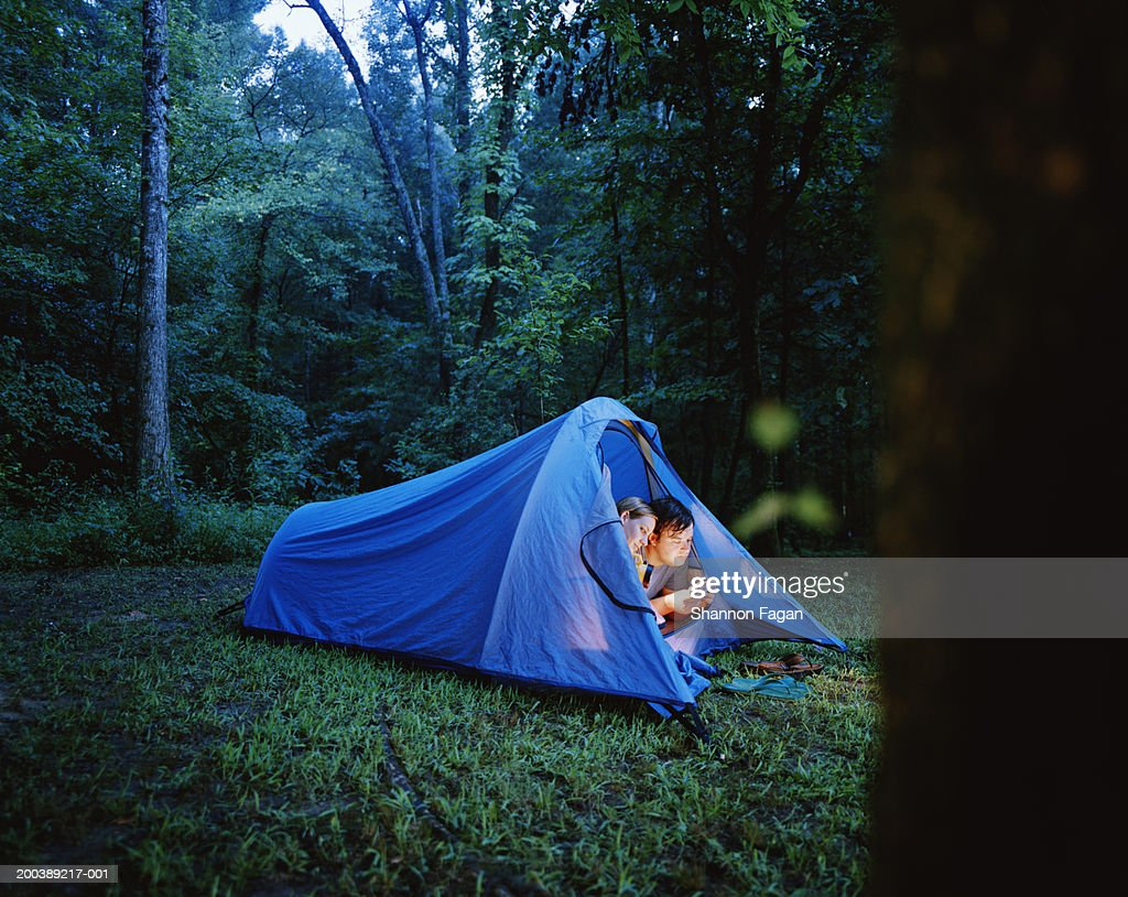 young couple camping in tent dusk summer ストックフォト getty images