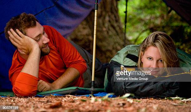 A young couple camping in the redwood forests of Big Sur.