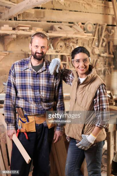 Young couple carpenter workers