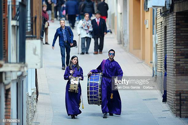 A young couple carry their drums towards festivities during Holy Week celebrations on March 25 2016 in Calanda Spain