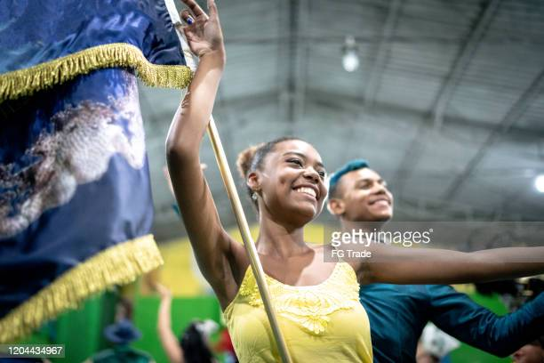 young couple celebrating and dancing brazilian carnival at school carnival - parade stock pictures, royalty-free photos & images