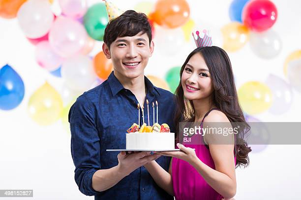 Young couple celebrating birthday