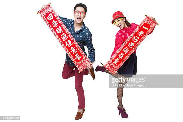 Young couple celebrating Chinese new year with couplets