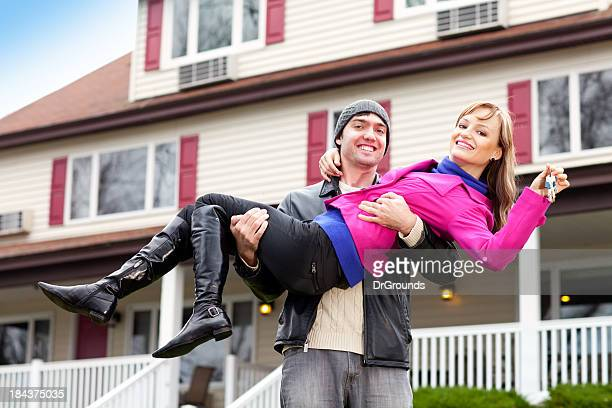 Young couple celebrating purchase of their first home