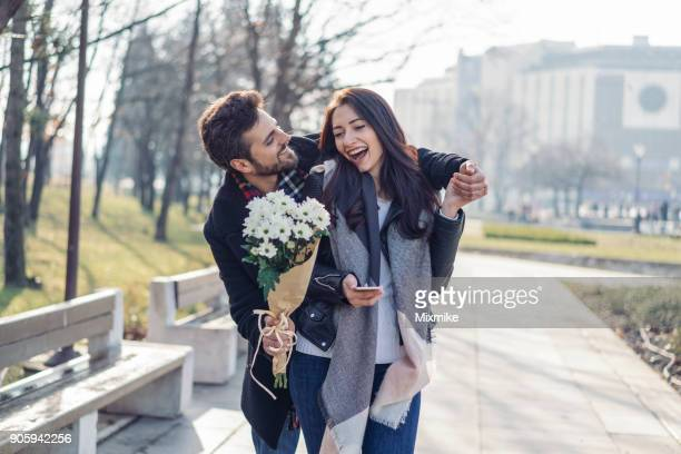 young couple celebrating valentine's day - valentine's day stock photos and pictures