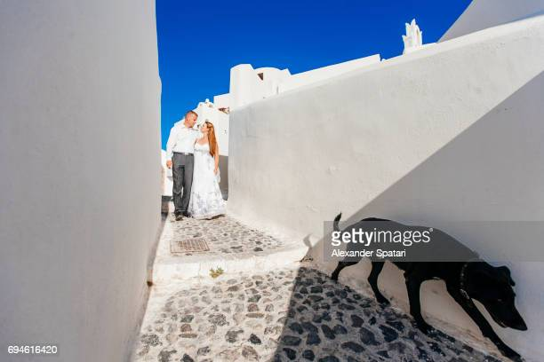 Young couple celebrating wedding at Santorini island, Cyclades, Greece