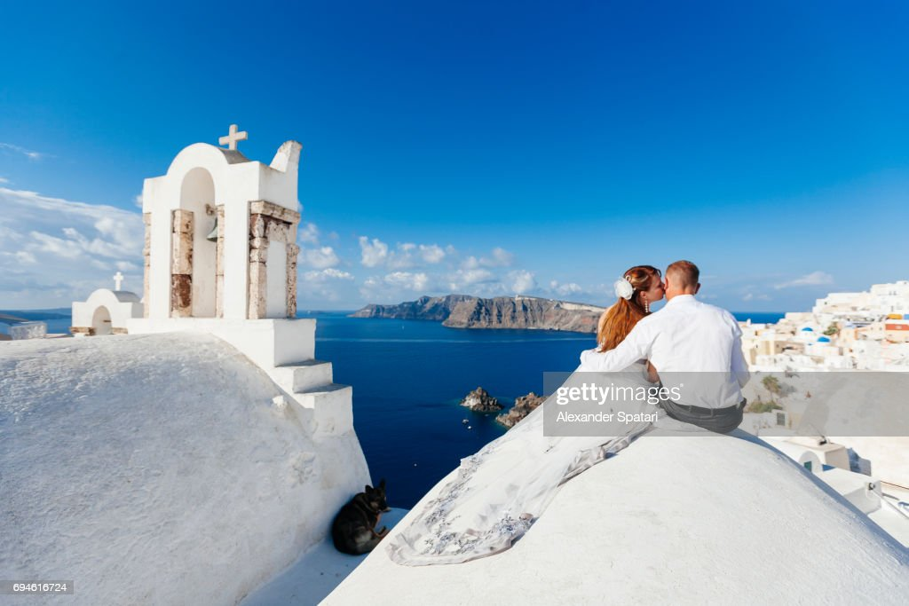 Young couple celebrating wedding at Santorini island, Cyclades, Greece : Stock Photo