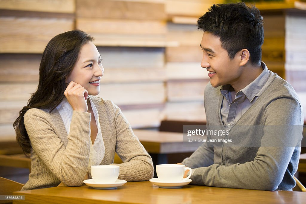 Young couple chatting in cafe : Stock Photo