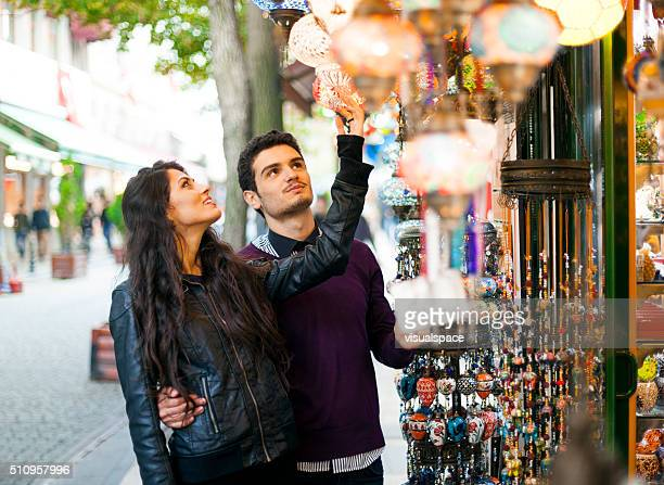 Young Couple Checking Out Goods in the Street Market