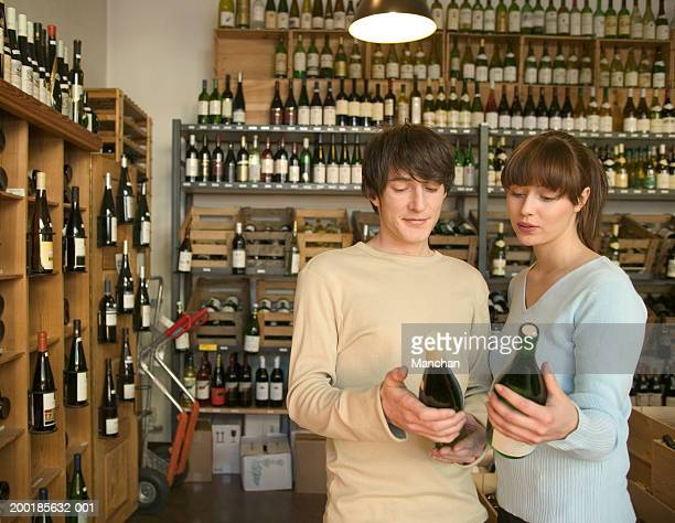 Young couple choosing bottles of wine