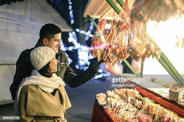 Young couple choosing sweet food