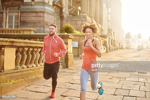 young couple city running - liverpool training stock pictures, royalty-free photos & images